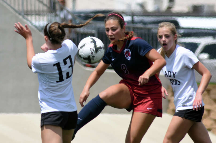 Katy Tompkins junior midfielder Kayla Ruopp, center, controls the ball against Austin Vandegrift senior midfielder Jocie Lackey (13) during the first half of their Class 6A Girls semifinal matchup at the 2017 UIL Soccer State Championships at Birkelbach Field in Georgetown on April 14, 2017. (Photo by Jerry Baker/Freelance) Photo: Jerry Baker, For The Chronicle / Freelance