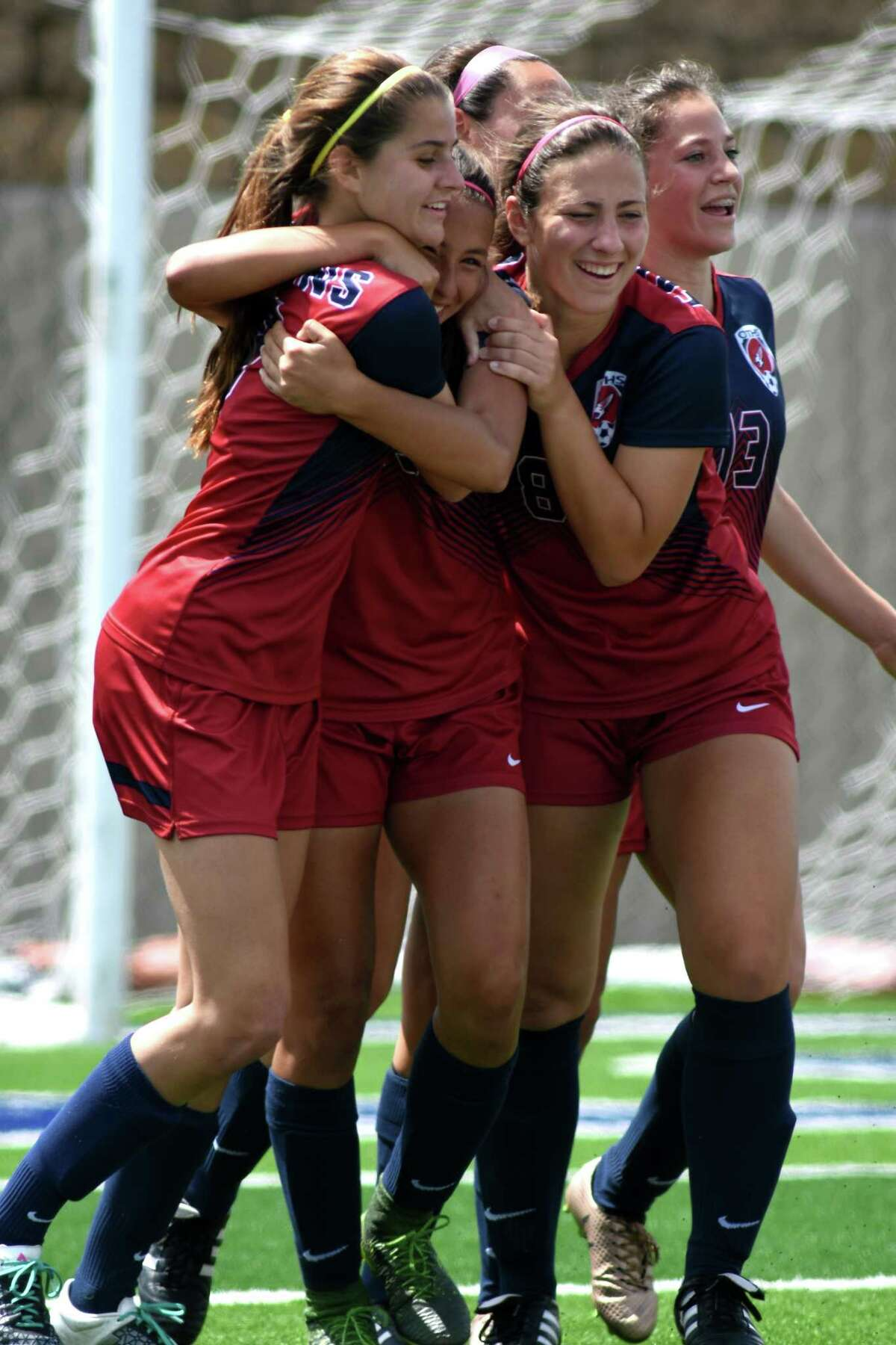 Katy Tompkins' Elana Wolf, from left, Barbara Olivieri, Kayla Ruopp, and Terin Graham celebrate Olivieri's first half goal against Austin Vandegrift during their Class 6A Girls semifinal matchup at the 2017 UIL Soccer State Championships at Birkelbach Field in Georgetown on April 14, 2017. (Photo by Jerry Baker/Freelance)