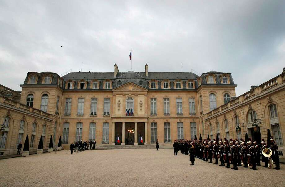 Republican guards, right, line up in the courtyard of the presidential Elysee Palace, in Paris, Friday, April 14, 2017. The two-round presidential election is set for April 23 and May 7. (AP Photo/Christophe Ena) Photo: Christophe Ena, STF / Copyright 2017 The Associated Press. All rights reserved.