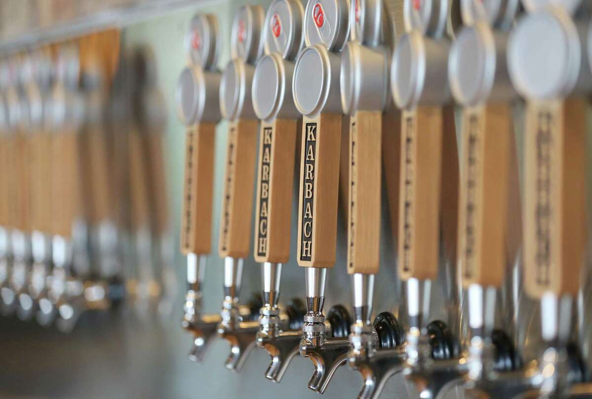 A row of taps is seen during a tour of the new Karbach Brewing Co. brewery Thursday, April 23, 2015, in Houston. ( Jon Shapley / Houston Chronicle )
