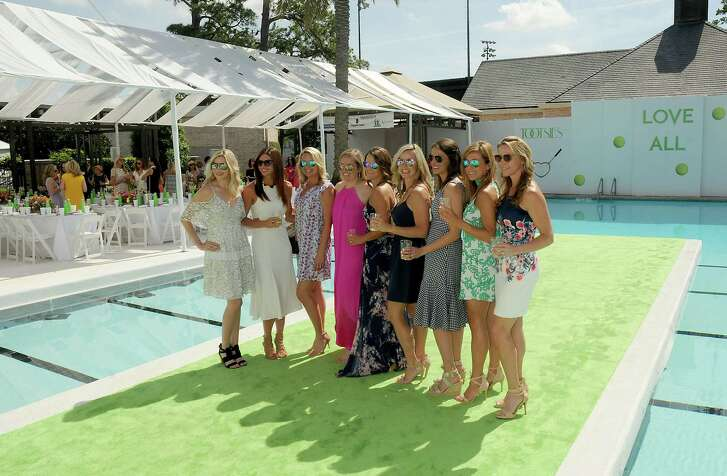 Far left: Ashley Pearce, left, and Dancie Ware  Left: Luncheon-goers pose on the green carpet before the Tootsies fashion show at River Oaks Country Club.