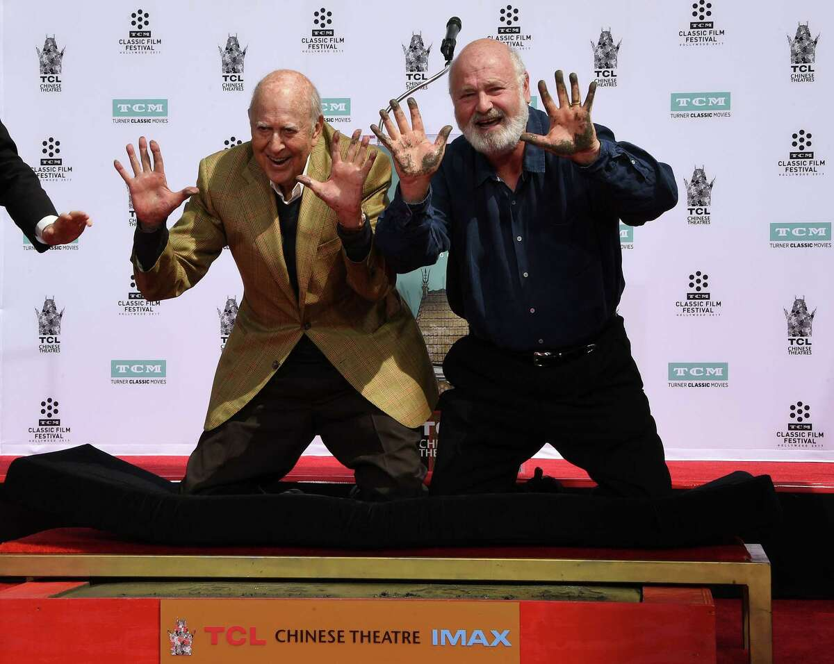Reiner, right, and his father, Carl Reiner, are honored with a hand- and footprint ceremony at Grauman's Chinese Theatre.