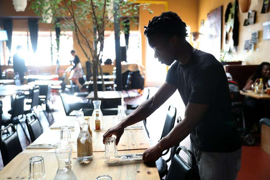Demonte Lane, now a busser at Kingston 11 in Uptown Oakland, says he had a front-of-house position at his first restaurant job but was demoted and fired after a white man was hired and given raises for the same type of work. Photo: Scott Strazzante, The Chronicle