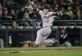 Houston Astros' Josh Reddick scores against the Seattle Mariners in the seventh inning of a baseball game Wednesday, April 12, 2017, in Seattle. (AP Photo/Elaine Thompson)