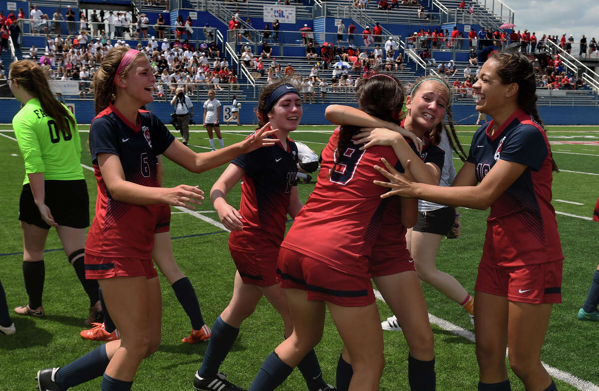 Katy Tompkins freshman midfielder Lauryn Wild, center, celebrates with teammates Leanne Veary, from left, Mikylin York, JoAnnie Ramos and Seanna McCarty after their 3-1 win over Austin Vandegrift in their Class 6A Girls semifinal matchup at the 2017 UIL Soccer State Championships at Birkelbach Field in Georgetown on April 14, 2017. (Photo by Jerry Baker/Freelance)