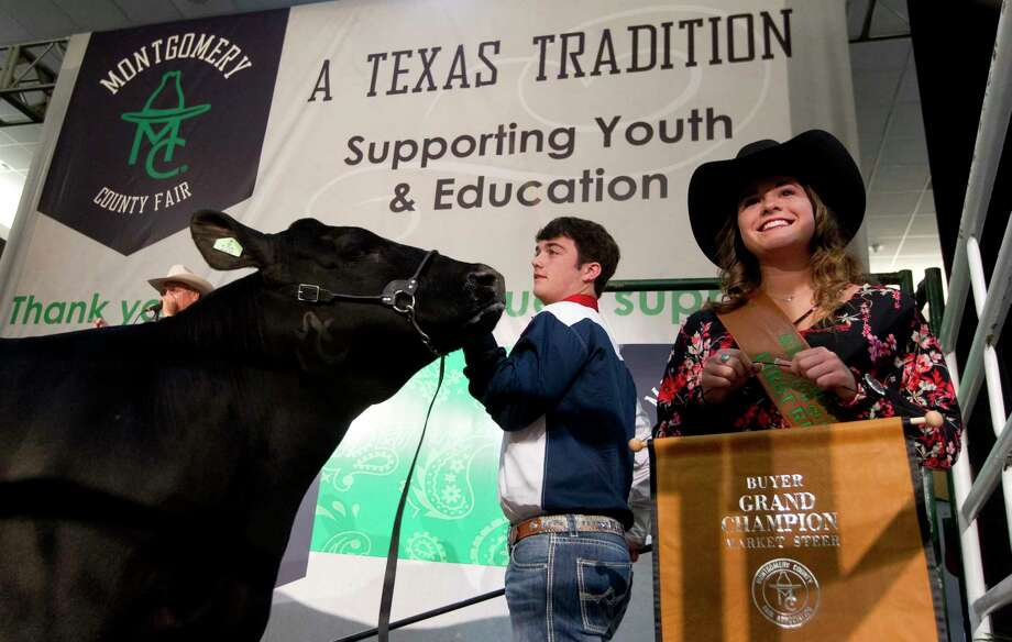 Jakob Dunn of Splendora FFA shows his grand champion steer during the Montgomery County Fair & Rodeo Junior Livestock Auction at the Lone Star Convention & Expo Center on Wednesday, April 5, 2017. Dunn's steer sold for $40,000. Photo: Jason Fochtman, Staff Photographer / © 2017 Houston Chronicle