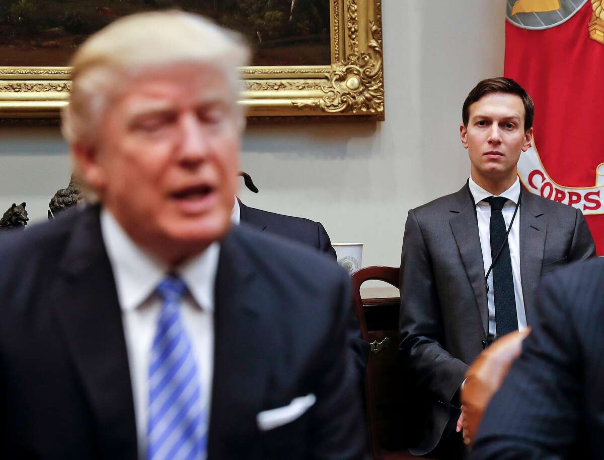 In this Jan. 23, 2017, file photo, White House Senior Adviser Jared Kushner listens at right as President Donald Trump speaks during a breakfast with business leaders in the Roosevelt Room of the White House in Washington. Kushner has been a power player able to avoid much of the harsh scrutiny that comes with working in the White House, but he's found that even the president's son-in-law takes his turn in the spotlight. (AP Photo/Pablo Martinez Monsivais, File)