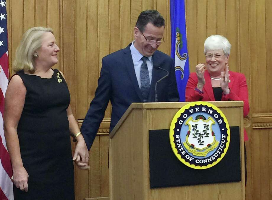 Connecticut Gov. Dannel P. Malloy holds the hand of his wife Cathy after announcing that he will not seek a third term in 2018 during a press conference on Thursday, April 13, 2017, at the Capitol in Hartford, Conn. Applauding is Lt. Gov. Nancy Wyman, right. Photo: Susan Haigh / Associated Press / Copyright 2017 The Associated Press. All rights reserved.