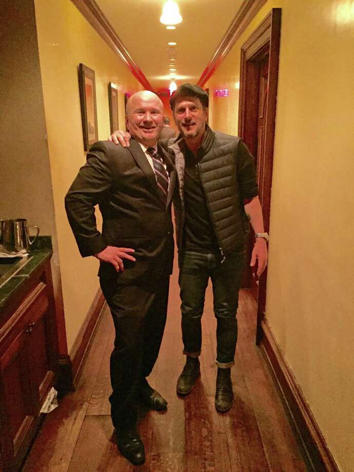 Tony Capasso, maitre'd and managing partner of Gabriele's with singer Rob Thomas. Photo: Contributed