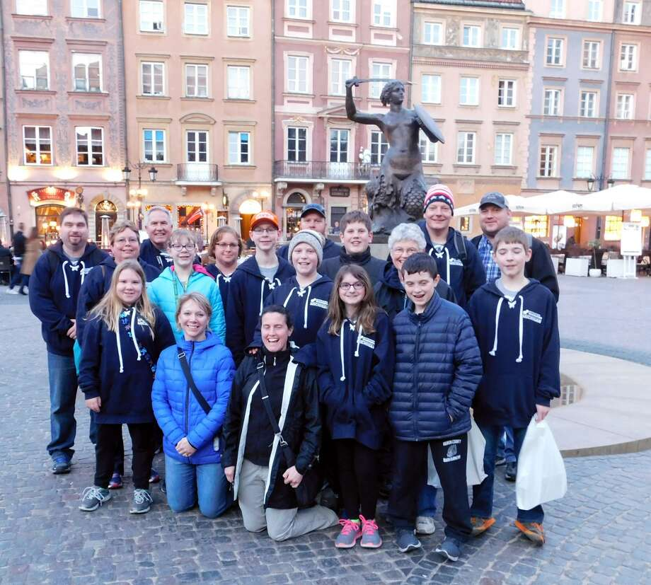 The Bad Axe Destination Imagination team members and their chaperones pose in front of the Symbol of Warsaw statue during their recent visit to Poland last month. (Submitted photo)