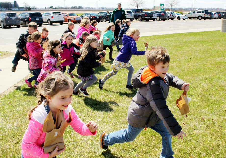 The kindergarteners couldn't wait to get their hands on as many treasure-filled eggs as they could find.