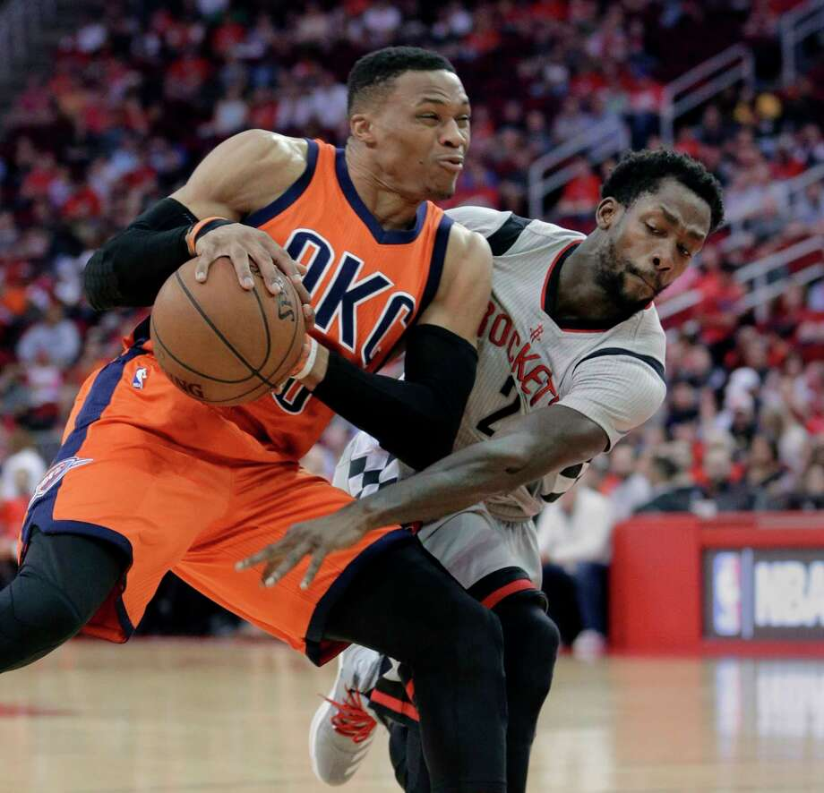 Oklahoma City Thunder's Russell Westbrook (0) protects the ball from the steal attempt by Houston Rockets' Patrick Beverley (2) in the first half of an NBA basketball game in Houston, Sunday, March 26, 2017. (AP Photo/Michael Wyke) Photo: Michael Wyke, FRE / FR33763 AP