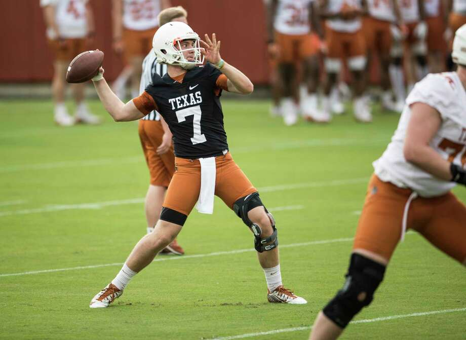 Quarterback Shane Buechele throws during a passing drill at the Longhorns' spring practice on Tuesday, March 7, 2017. Photo: Ricard B. Brazziell, PHOTOJOURNALIST