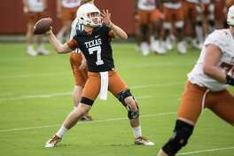 Quarterback Shane Buechele throws during a passing drill at the Longhorns' spring practice on Tuesday, March 7, 2017.