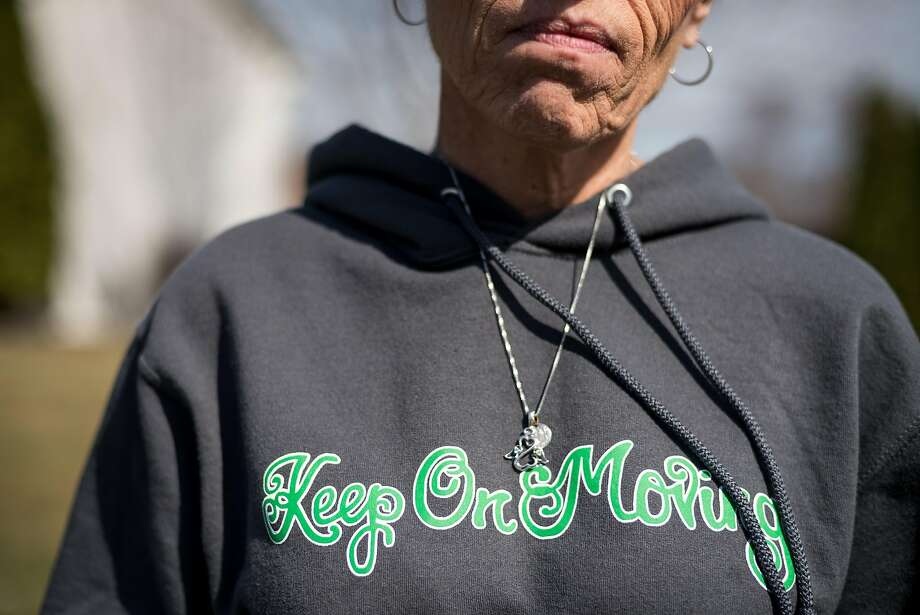 """Peggy Riggs wears a sweatshirt that reads, """"Keep on moving,"""" in honor of her son David, who was killed by a young driver who was texting. """"Keep on moving"""" was a phrase David had tattooed on his foot, and it has become the motto for his parents' efforts to educate and push for stricter laws against texting and driving. Photo: Caroline Yang, Caroline Yang / Special To The Chronicle"""