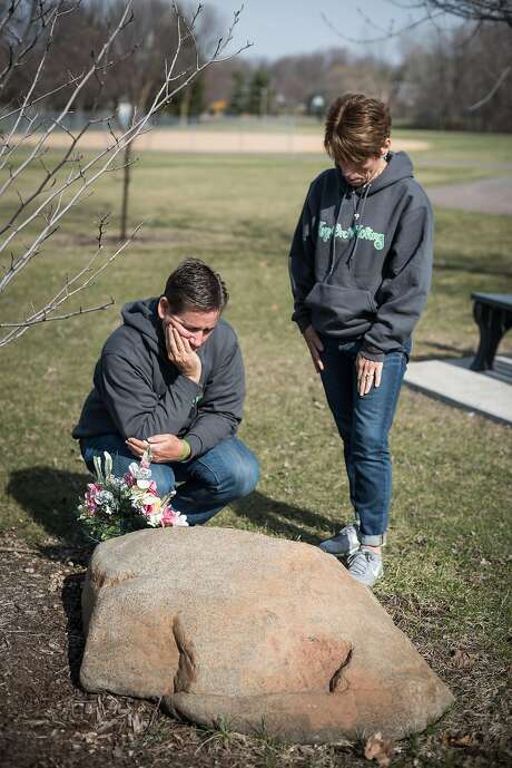 Peggy and Craig Riggs visit a memorial to their son David at a park in Oakdale, Minn. David Riggs died after being hit by a driver who was texting and driving in 2013. Photo: Caroline Yang, Caroline Yang / Special To The Chronicle