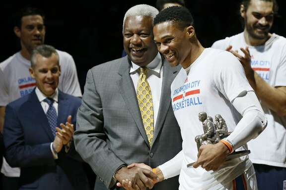 Oklahoma City Thunder guard Russell Westbrook, right, is congratulated by Oscar Robertson, left, on his triple-double record before an NBA basketball game between the Denver Nuggets and the Oklahoma City Thunder in Oklahoma City, Wednesday, April 12, 2017. (AP Photo/Sue Ogrocki)