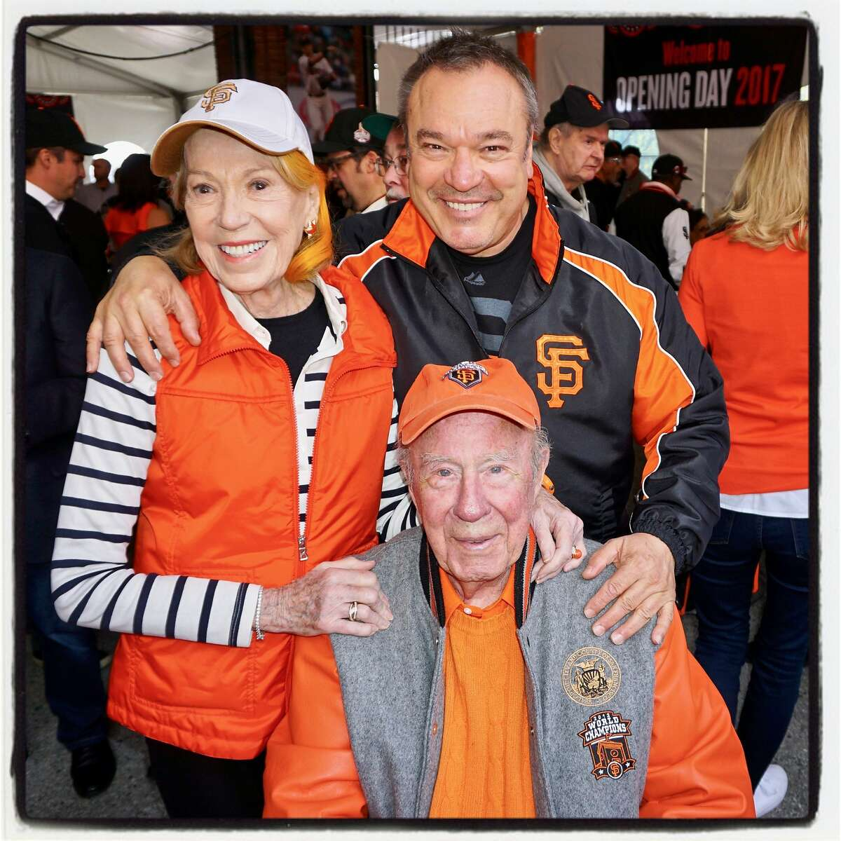 Charlotte Shultz and Stanlee Gatti (standing) celebrate Giants opening day with George Shultz AT&T ballpark. April 10, 2017.