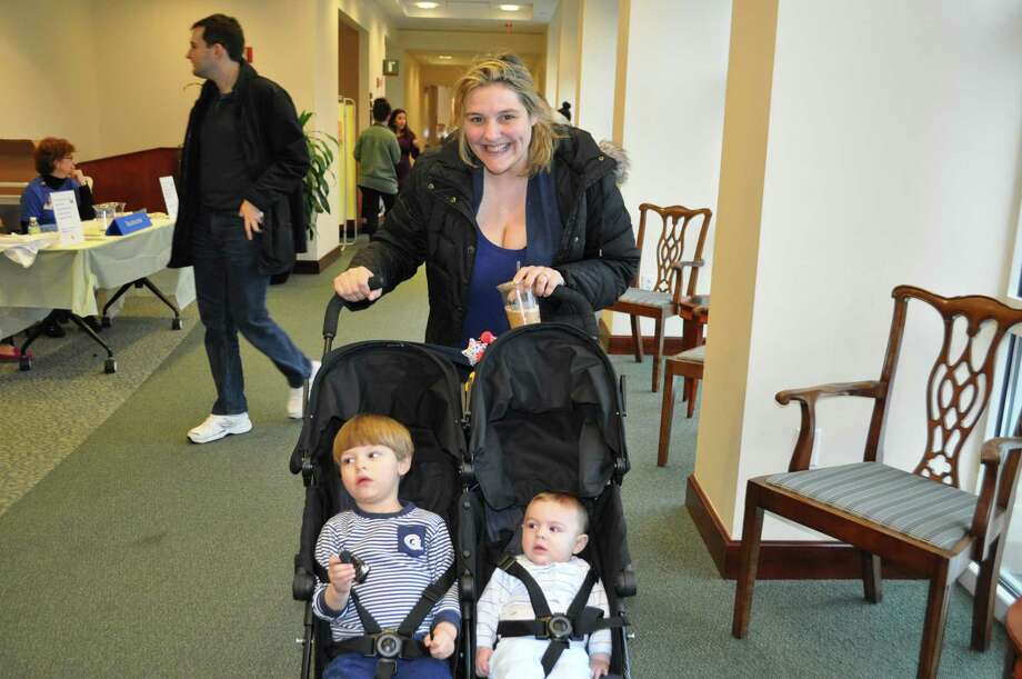 "Greenwich Hospital's 10th annual Pregnancy Primer Fair was a family affair, drawing scores of parents-to-be from Connecticut and New York. ""People appreciated being able to speak one-on-one with so many of our healthcare experts. The tours of the birthing center were also a big hit,"" said Patricia Basciano, RN, nurse manager for Women's and Children's Services at Greenwich Hospital.  About 65 people attended the free March 25 event, which offered a ""one-stop shopping"" educational experience for parents-to-be and those just thinking about becoming pregnant. The fair provided information about what to expect before, during and after childbirth.  People were able to speak with obstetricians, gynecologists, fertility specialists, anesthesiologists, pediatricians, neonatal intensive care unit nurses, breastfeeding consultants and yoga/meditation instructors. Greenwich Hospital welcomed more than 2,800 newborns last year. Among the experts on hand was Dr. Catherine Berzolla (pictured), an obstetrician who brought her own children to the fair. Photo: Contributed"