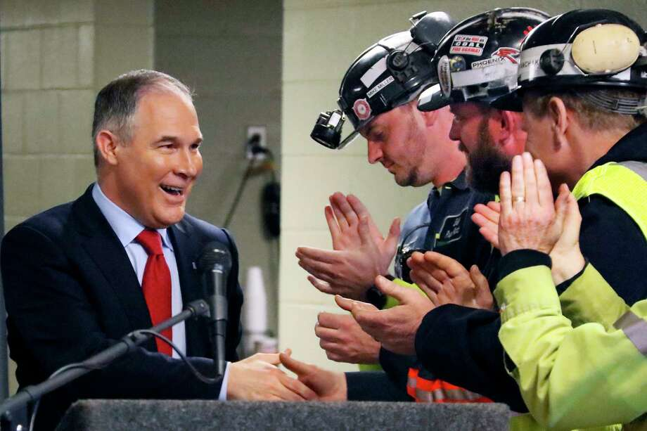 "Environmental Protection Agency Administrator Scott Pruitt, greeting coal miners in Pennsylvania this week, says the Paris climate accord is ""a bad deal for America."" ore, Pa. The Trump administration wants to trash Obama-era rules to limit water pollution from coal-fired power plants. Pruitt announced the change this week. Administrator Scott Pruitt sent a letter to a coalition of energy companies that lobbied against the 2015 water pollution rule.  (AP Photo/Gene J. Puskar, File) Photo: Gene J. Puskar, STF / Copyright 2017 The Associated Press. All rights reserved."