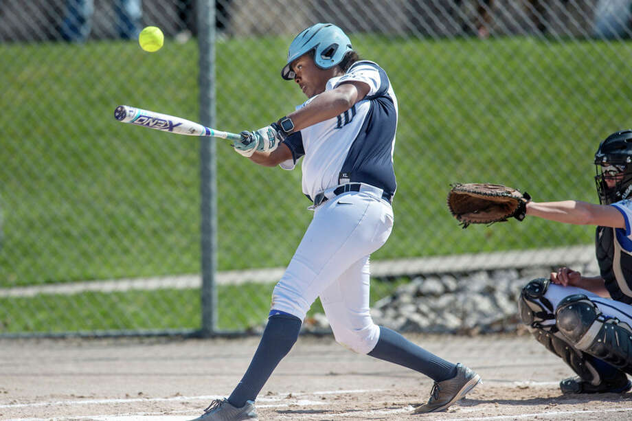 BRITTNEY LOHMILLER | blohmiller@mdn.net Northwood's Torriya Gray-Baker swings at a pitch from Grand Valley State's Allison Lipovsky during Friday's doubleheader. / Midland Daily News