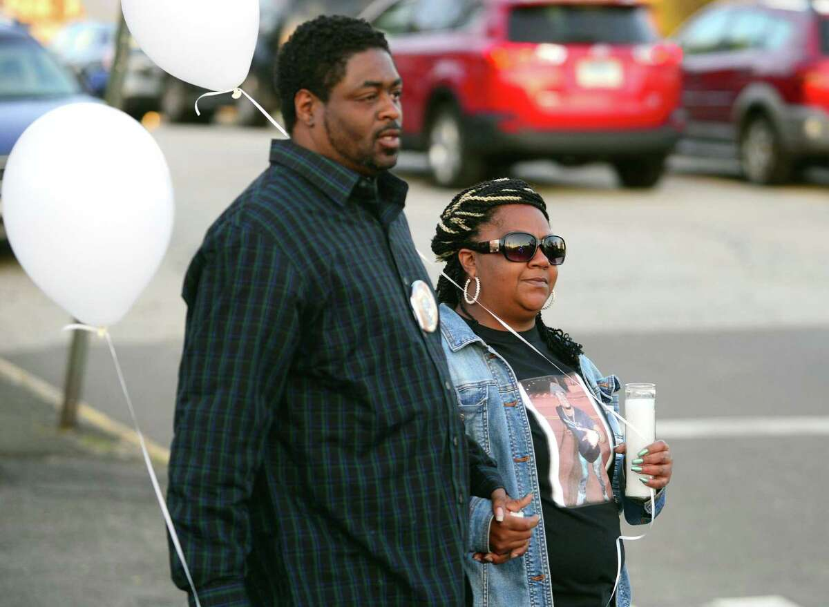 Shannon Samuels and Chanel Howard, parents of Shyheim Samuel, walk to their home nearby after attending a service held at New Beginning Church of God situated inside Derby United Methodist Church at Elizabeth and Fifth Streets in Derby, Conn., on Friday Apr. 14, 2017. Samuel who turned 20 years-old on Monday was killed late Tuesday evening in a one car accident in Seymour. Five other people in the vehicle were injured.
