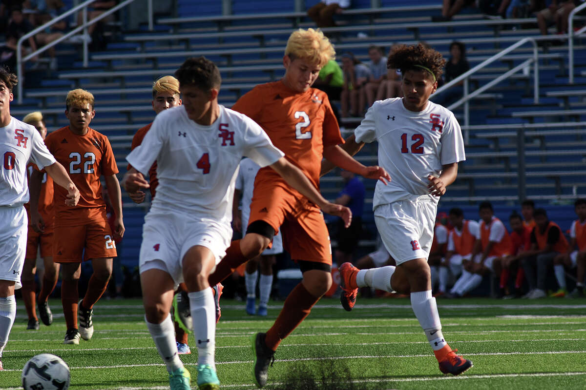 Dobie sophomore forward Alberto Chavez splits a pair of Arlington Houston defenders while working the upfield during the first period of their Class 6A Boys semifinal matchup at the 2017 UIL Soccer State Championships at Birkelbach Field in Georgetown on April 14, 2017. (Photo by Jerry Baker/Freelance)