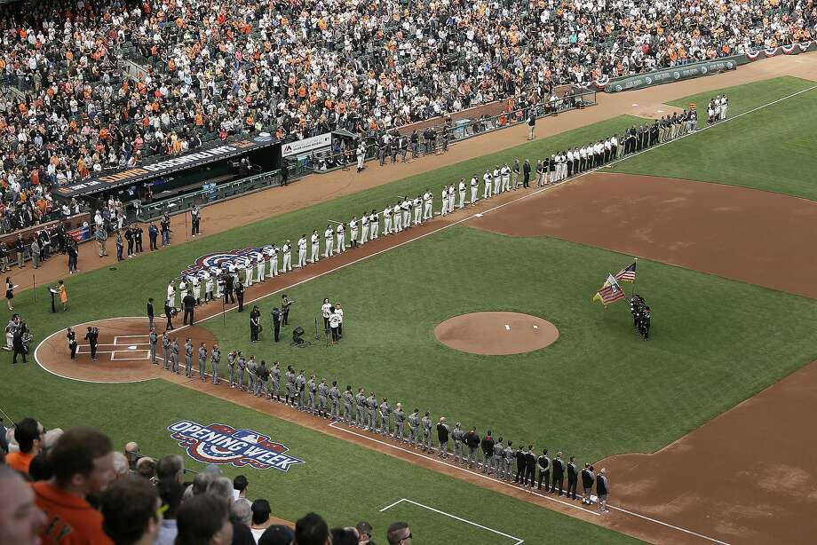 Members from the cast of the musical Hamilton sing the national anthem on opening day as the San Francisco Giants, top, and Arizona Diamondbacks, bottom, line the bases before the start of a baseball game, Monday, April 10, 2017, in San Francisco. (AP Photo/Eric Risberg) Photo: Eric Risberg, Associated Press