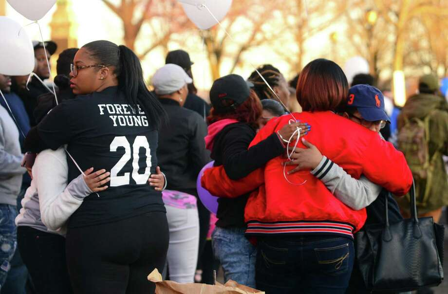 A vigil for Shyheim Samuel was held in front of his home on Fifth Street in Derby, Conn., on Friday Apr. 14, 2017. Samuel who turned 20 years-old on Monday was killed late Tuesday evening in a one car accident in Seymour. Five other people in the vehicle were injured. Before the vigil there was a short service nearby at New Beginning Church of God, led by pastor Dennis Marroquin. They hold services in the basement of Derby United Methodist Church. Photo: Christian Abraham / Hearst Connecticut Media / Connecticut Post