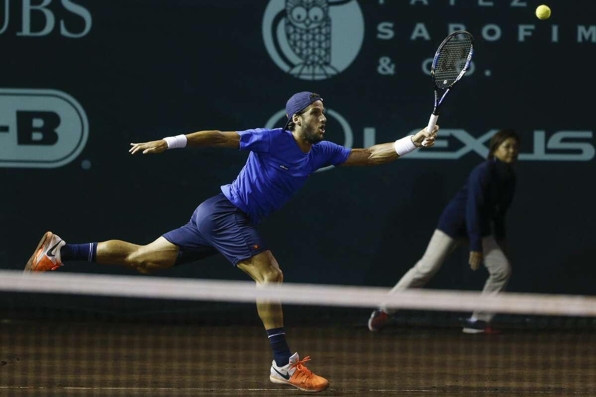 Feliciano Lopez just misses the ball as he takes on Jack Sock in the quarterfinals of the US Men's Clay Court Championship Friday, April 14, 2017 in Houston. ( Michael Ciaglo / Houston Chronicle)