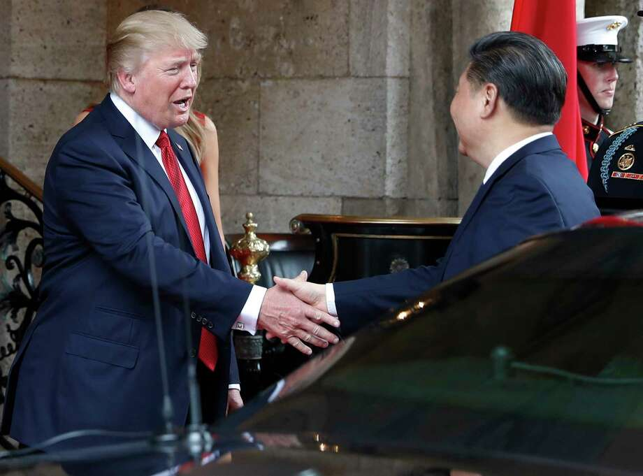 President Donald Trump  greets   Chinese President  Xi Jinping as he arrives before dinner at the  Mar-a-Lago resort earlier this month. Photo: Alex Brandon, STF / Copyright 2017 The Associated Press. All rights reserved.