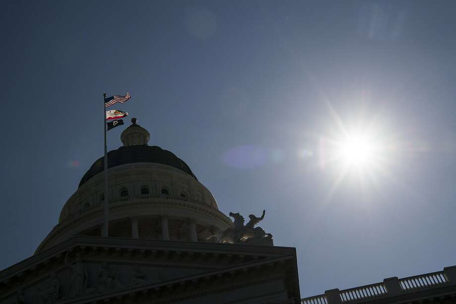 The American, California State, and POW/MIA flags fly in front of the California State Capitol building in Sacramento. Photo: David Paul Morris, Bloomberg