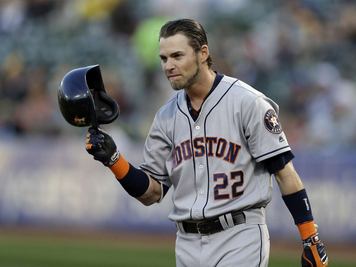 Houston Astros' Josh Reddick (22) tips his helmet to fans as he comes to bat against the Oakland Athletics in the first inning of a baseball game Friday, April 14, 2017, in Oakland, Calif. This is Reddick's first return to Oakland since July of 2016, when he was a right fielder for the Athletics. (AP Photo/Ben Margot)