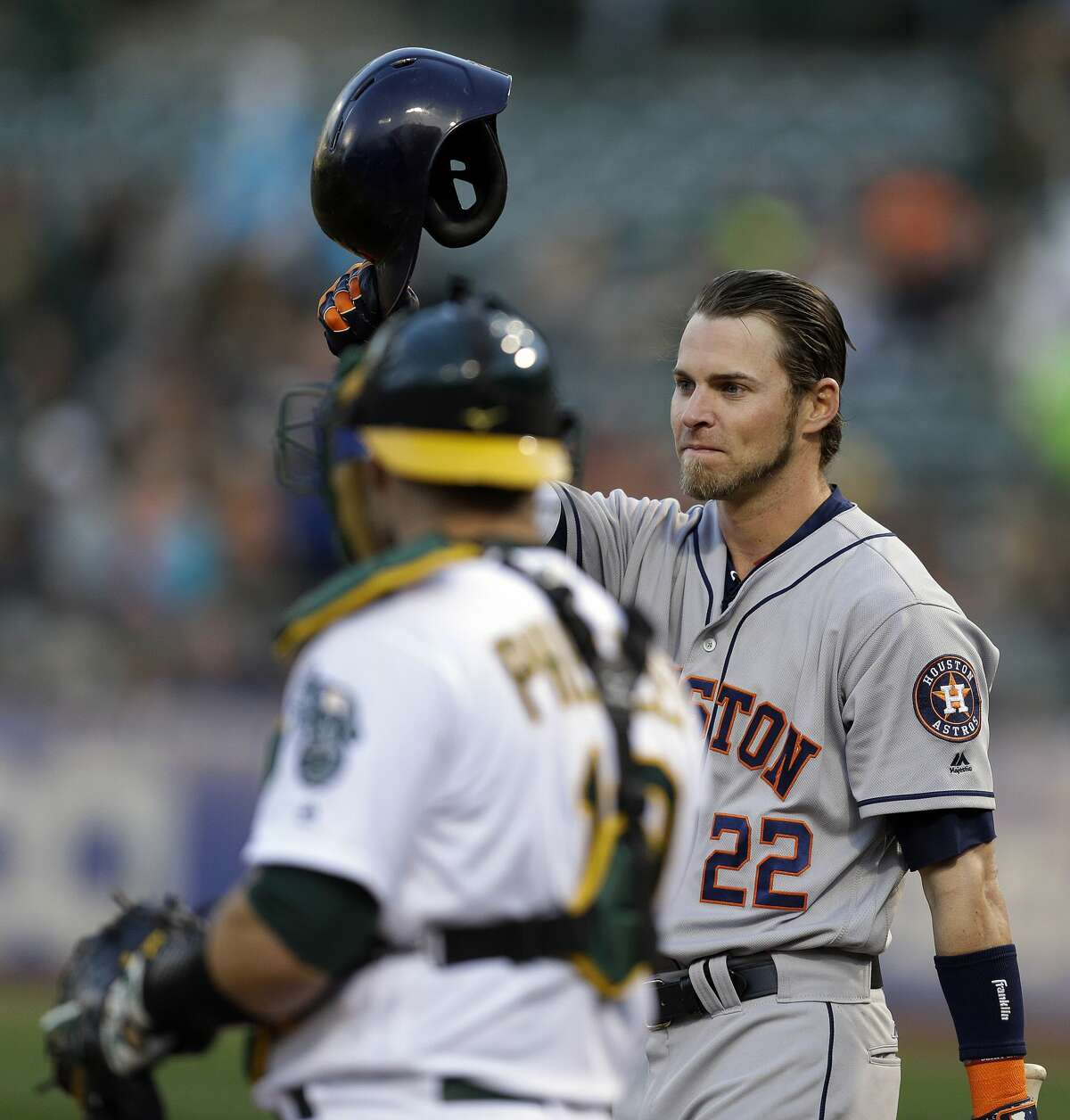 Houston Astros' Josh Reddick (22) tips his helmet to fans as he comes to bat against the Oakland Athletics in the first inning of a baseball game Friday, April 14, 2017, in Oakland, Calif. This is Reddick's first return to Oakland since July 2016, when he was a right fielder for the Athletics. (AP Photo/Ben Margot)