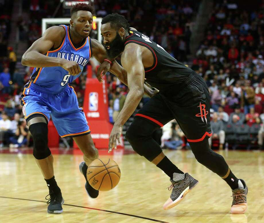Houston Rockets guard James Harden (13) drives past Oklahoma City Thunder guard Victor Oladipo (5) during the first quarter of an NBA game at the Toyota Center, Thursday, Jan. 5, 2017, in Houston. ( Jon Shapley / Houston Chronicle ) Photo: Jon Shapley, Staff / © 2015  Houston Chronicle