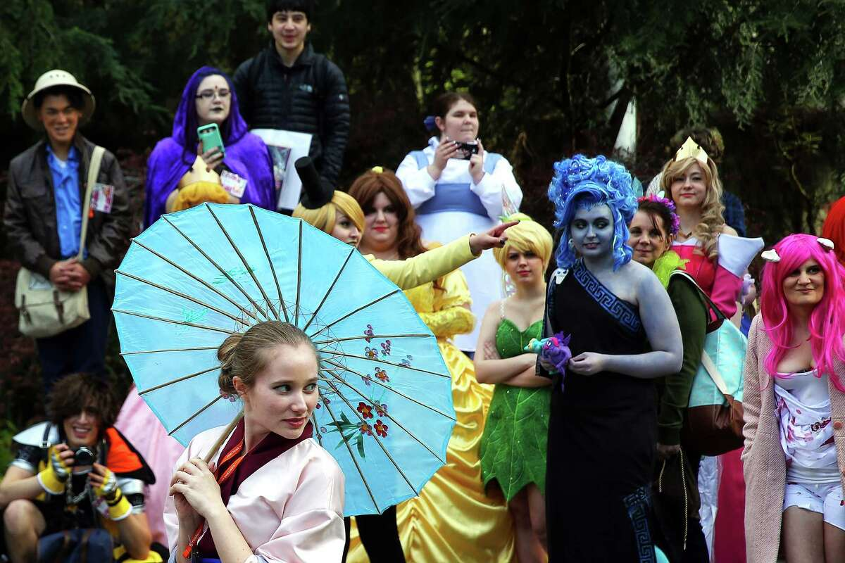 Disney cosplayers gather during the Sakura-Con anime convention, Friday, April 14, 2017 at the Washington State Convention Center in Seattle.