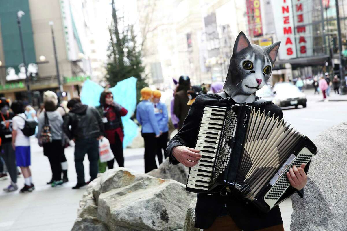 A cool cat plays the accordion outside the Sakura-Con anime convention.