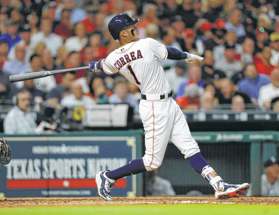 The Astros' Carlos Correa had a key two-run double in the seventh inning of a 6-2 win against the Texas Rangers on Monday. Photo: Karen Warren, Staff Photographer / Stratford Booster Club