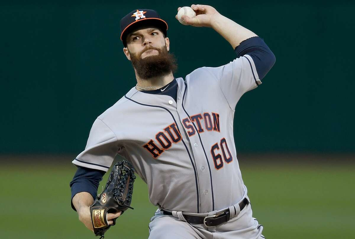 OAKLAND, CA - APRIL 14: Dallas Keuchel #60 of the Houston Astros pitches against the Oakland Athletics in the bottom of the first inning at Oakland Alameda Coliseum on April 14, 2017 in Oakland, California. (Photo by Thearon W. Henderson/Getty Images)