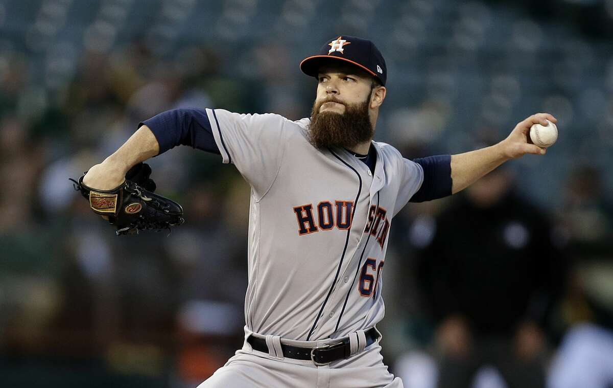 Houston Astros pitcher Dallas Keuchel works against the Oakland Athletics during the first inning of a baseball game Friday, April 14, 2017, in Oakland, Calif. (AP Photo/Ben Margot)