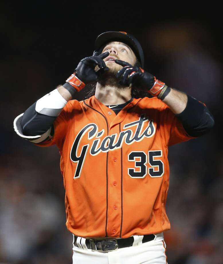 San Francisco Giants' Brandon Crawford gestures as he crosses home plate after hitting a home run against the Colorado Rockies during the fourth inning of a baseball game, Friday, April 14, 2017, in San Francisco. (AP Photo/Tony Avelar) Photo: Tony Avelar, Associated Press