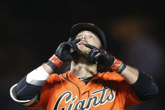 San Francisco Giants' Brandon Crawford gestures as he crosses home plate after hitting a home run against the Colorado Rockies during the fourth inning of a baseball game, Friday, April 14, 2017, in San Francisco. (AP Photo/Tony Avelar)