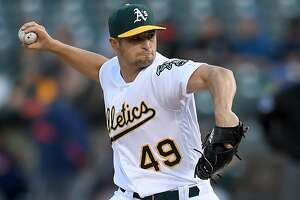 OAKLAND, CA - APRIL 14:  Kendall Graveman #49 of the Oakland Athletics pitches against the Houston Astros in the top of the first inning at Oakland Alameda Coliseum on April 14, 2017 in Oakland, California.  (Photo by Thearon W. Henderson/Getty Images)