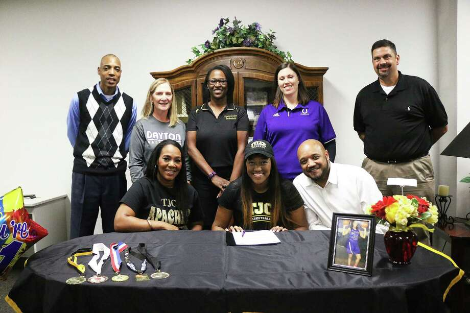 Londan Mallett has signed a scholarship with Tyler Junior College in Tyler, Texas. The senior says she is excited for what the future will bring her. Mallett, center, is joined by her parents Latonya and James Mallet, back row, her AAU coach, Lady Broncos head coach Suzanne Davis, Trenia Tillis-Jones, head coach at Tyler Junior College, Christie Alkire, Lady Broncos assistant head coach, and Dayton High School Principal Geoff McCracken. Photo: David Taylor