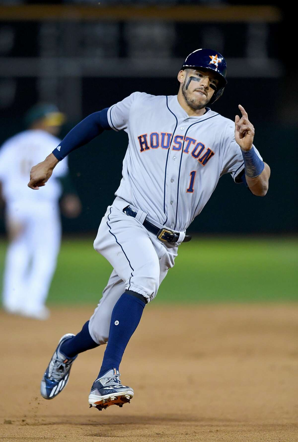 OAKLAND, CA - APRIL 14: Carlos Correa #1 of the Houston Astros runs the bases to score against the Oakland Athletics in the top of the seventh inning at Oakland Alameda Coliseum on April 14, 2017 in Oakland, California. (Photo by Thearon W. Henderson/Getty Images)