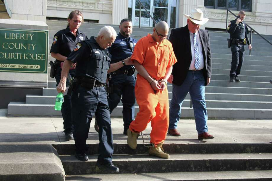 Frank Hernandez Jr. is led away from the Liberty County Courthouse to begin a life sentence for the Dec. 16, 2015, murder of a Cleveland convenience store clerk. Hernandez is one of four men accused of participating in the robbery. He admitted on the stand that he was the shooter. Photo: Vanesa Brashier
