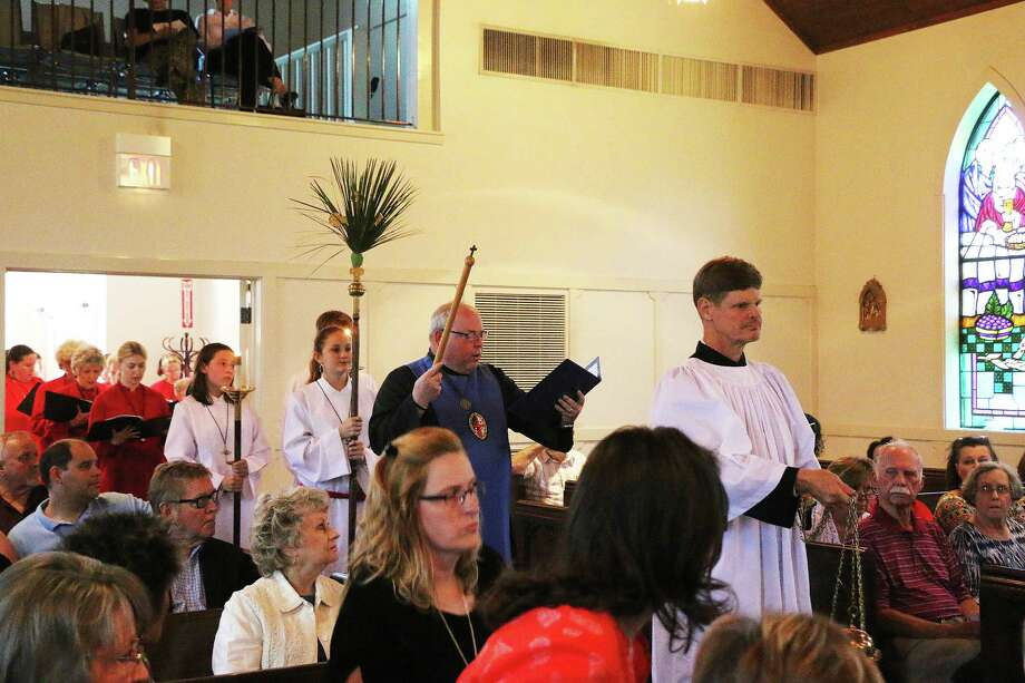 "The Palm Sunday Lenten Reflections concert procession at St. Stephen's Episcopal Church in Liberty on April 9 begins with the tune of Pange Lingua by Thomas Aquinas (c. 1264), ""Now my tongue the mystery telling."" Photo: Vanesa Brashier"