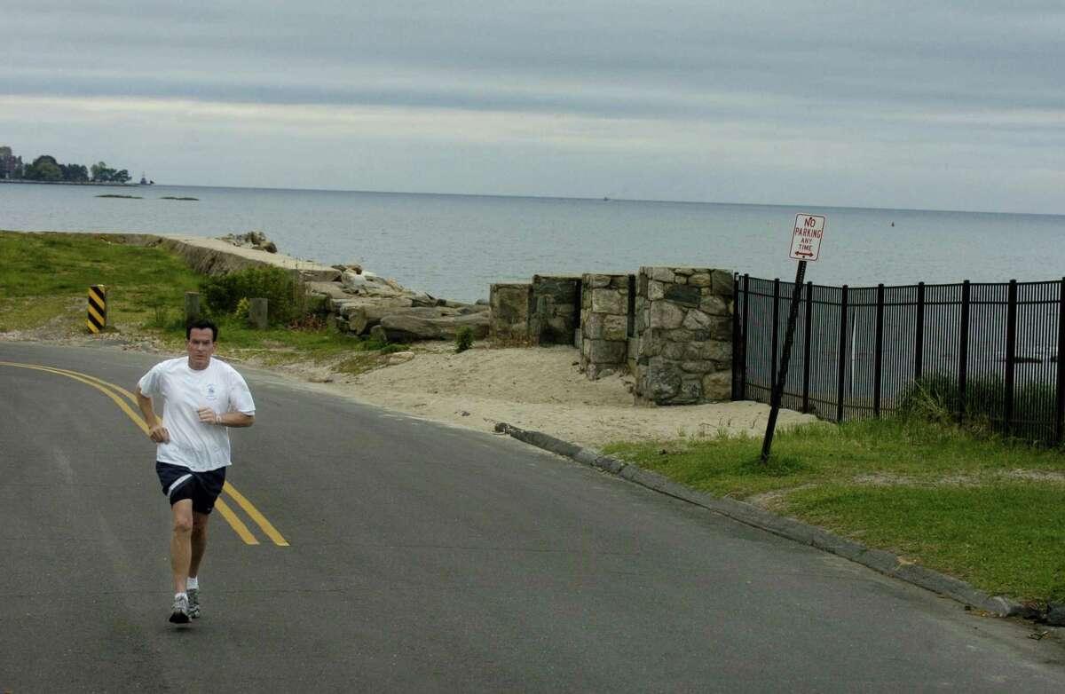 Then-Mayor Dannel Malloy takes an early morning run through his Shippan neighborhood.