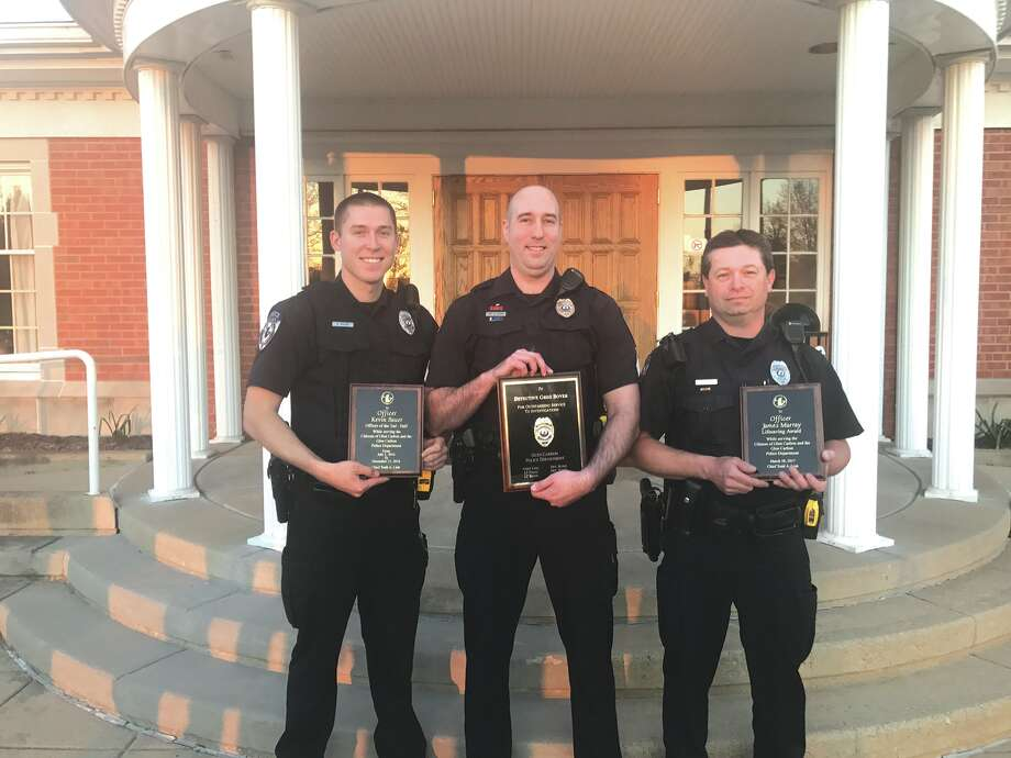 Members of the Glen Carbon Police Department were presented awards for their service and dedication to the village at the last regular meeting of the Village Board. Honored were. from left: Officer Kevin Bauer, Sgt. Greg Boyer and Officer James Murray. Photo: For The Intelligencer