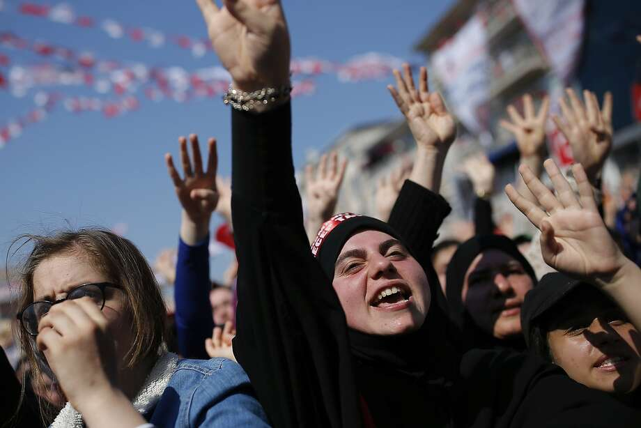 Supporters applaud Turkish President Recep Tayyip Erdogan at a rally in Istanbul. Erdogan's powers would be strengthened if the referendum is approved. The vote takes place Sunday. Photo: Emrah Gurel, Associated Press